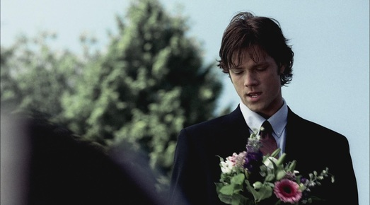 Sam visits Jess' grave