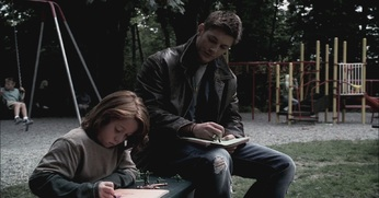 Dean and Lucas draw in the park